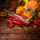 Rustic fall decor with pumpkin, red peppers - PhotoDune Item for Sale