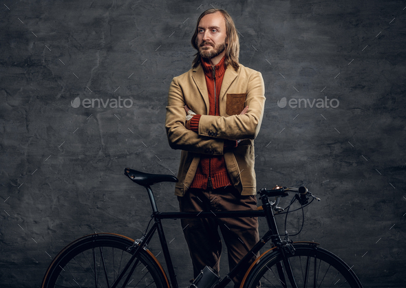A man posing with single speed bicycle over grey background. - Stock Photo - Images