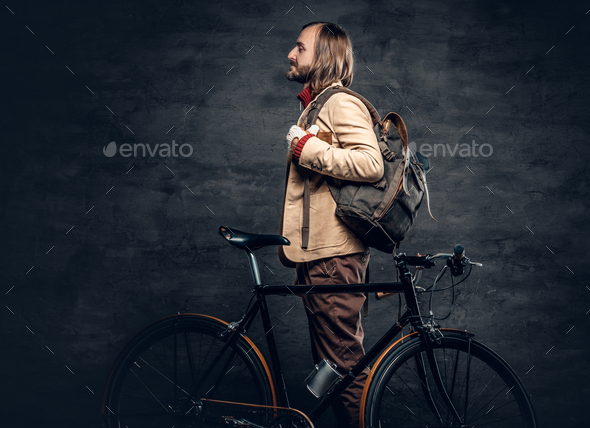 A man posing with bicycle. - Stock Photo - Images