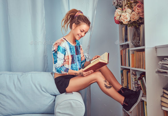 A beauty tattoed girl in casual clothes - Stock Photo - Images