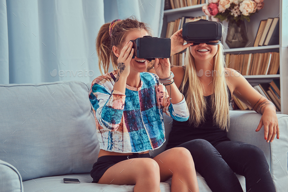 Two young girlfriends in casual clothes having fun - Stock Photo - Images