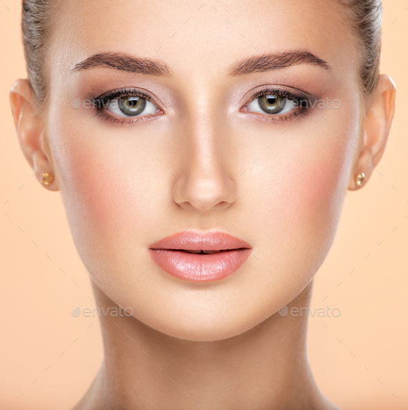 Beauty face concept. Young attractive girl with a healthy skin of  face posing in front of camera. - Stock Photo - Images