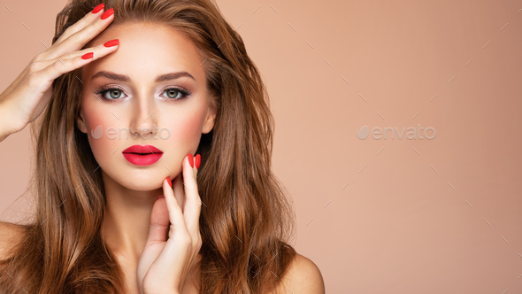 Model with fashion makeup.. Face of young woman with red lipstick and long brown hair. - Stock Photo - Images