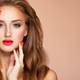 Model with fashion makeup.. Face of young woman with red lipstick and long brown hair. - PhotoDune Item for Sale