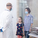 Pediatrician wearing face mask talking with patient - PhotoDune Item for Sale