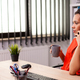Corporate businesswoman in workplace talking on phone - PhotoDune Item for Sale