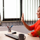Businesswoman greeting employee with wave during video conference - PhotoDune Item for Sale