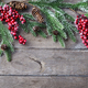 Christmas decoration background with fir tree and red berries. Wooden table. Copy space. Top view - PhotoDune Item for Sale