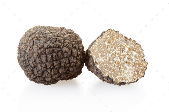 Black truffle and section isolated on white, clipping path included - Stock Photo - Images