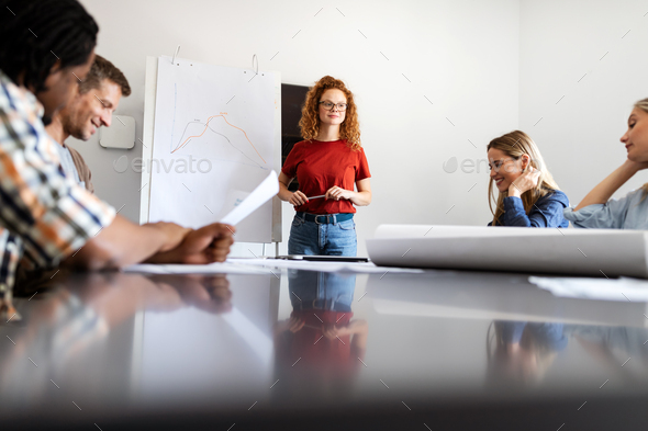 Group of diverse designers, business people brainstorming on meeting in office - Stock Photo - Images