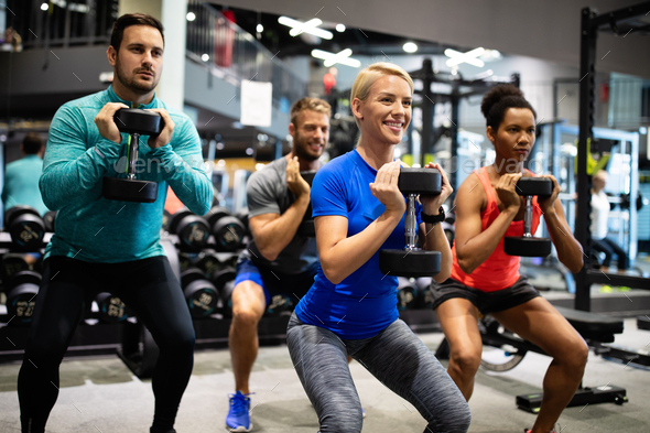 Fitness, sport, training, gym, success and lifestyle concept. Group of happy friends in the gym - Stock Photo - Images