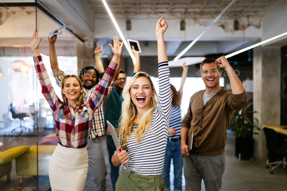 Group of successful happy business people in office celebrating profits - Stock Photo - Images