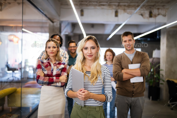 Successful company with happy employees in modern office - Stock Photo - Images
