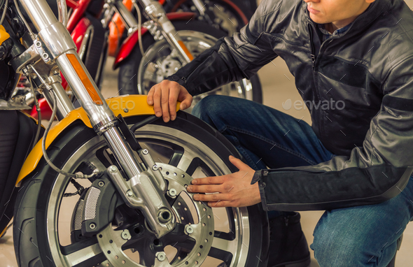 Man with motorbike - Stock Photo - Images