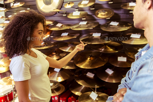 Woman in musical shop - Stock Photo - Images