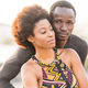 happy black race african couple at the beach in love and enjoying the leisure activity together - PhotoDune Item for Sale