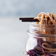Noodles Soba Salad, Soup with Vegetables, tofu and chicken in jars. Grey background. Close up. - PhotoDune Item for Sale