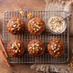 Carrot Oat Muffins, Cupcakes, Cakes on cooling rack. Wooden background. Top view. - PhotoDune Item for Sale
