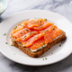 Sandwich, Toast with Smoked Salmon and cream cheese on white plate. Marble background. Close up. - PhotoDune Item for Sale