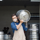 Young man working at warehouse in brewery or employee with keg - PhotoDune Item for Sale