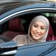 Smiling muslim woman test driving car in urban city - PhotoDune Item for Sale
