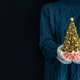 Cute woman holds decorated christmas tree in her hands. Merry Christmas and a Happy new year concept - PhotoDune Item for Sale