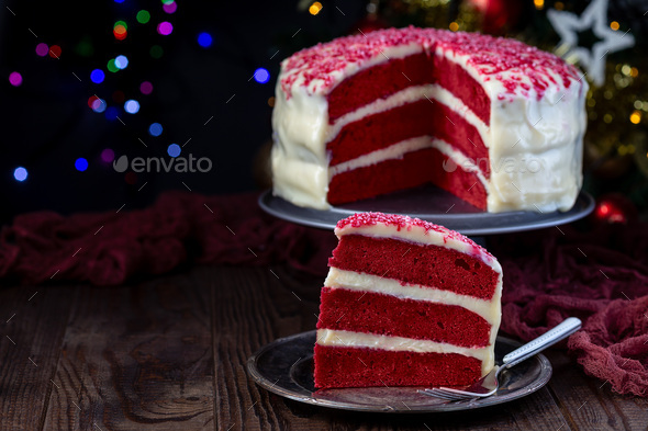 Piece of red velvet cake with cream cheese frosting - Stock Photo - Images