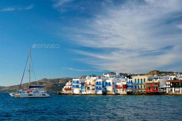 Sunset in Mykonos, Greece, with cruise ship and yachts in the harbor - Stock Photo - Images