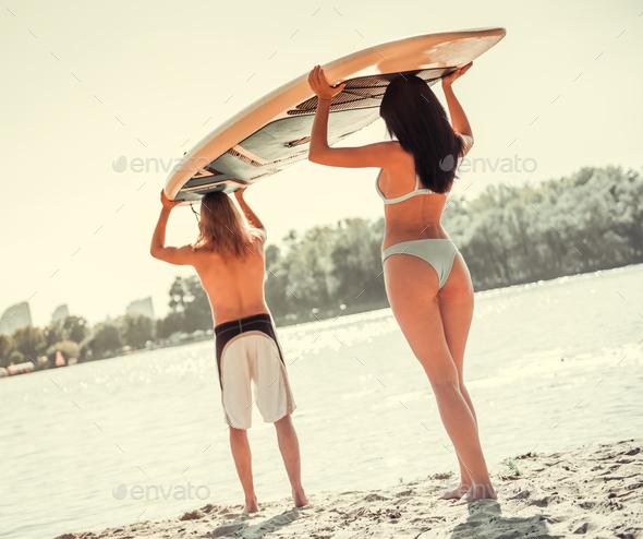 Couple standup paddleboarding - Stock Photo - Images