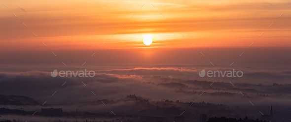 Panorama of Graz city covered if fog on autumn morning during sunraise - Stock Photo - Images