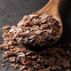 Grated dark chocolate. Chocolate flakes in wooden spoon. - PhotoDune Item for Sale