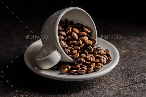 Roasted coffee beans in cup. - Stock Photo - Images