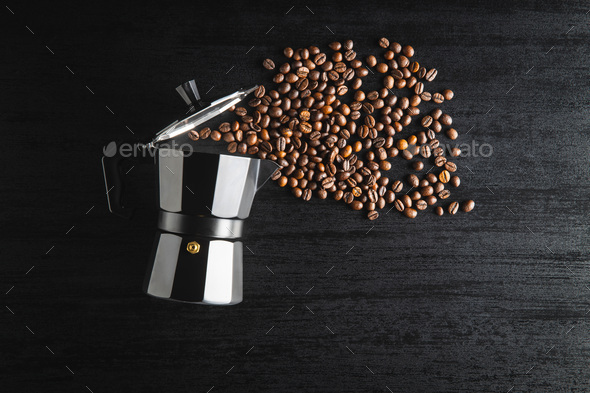 Coffee beans and bialetti coffee maker.  Moka pot - Stock Photo - Images