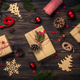 Christmas background with fir tree, present box and decorations at wooden table - PhotoDune Item for Sale