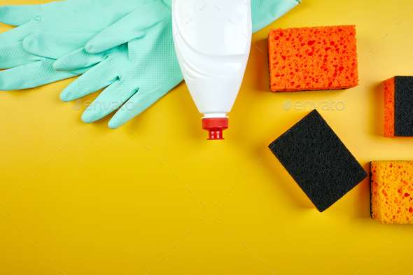 Flat lay of  cleaning set for dish washing yellow background with copy space - Stock Photo - Images
