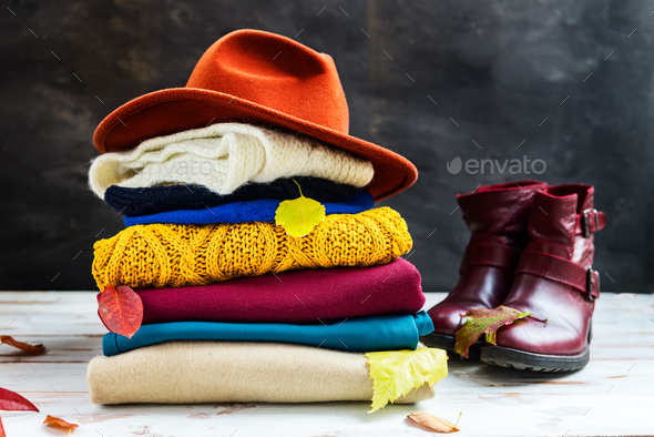 Stack of colorful warm autumn and winter clothes - Stock Photo - Images