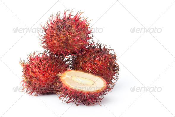 Fresh whole and half Rambutan fruit - Stock Photo - Images