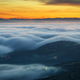Blue waves of fog before sunrise between mountains and valleys - PhotoDune Item for Sale