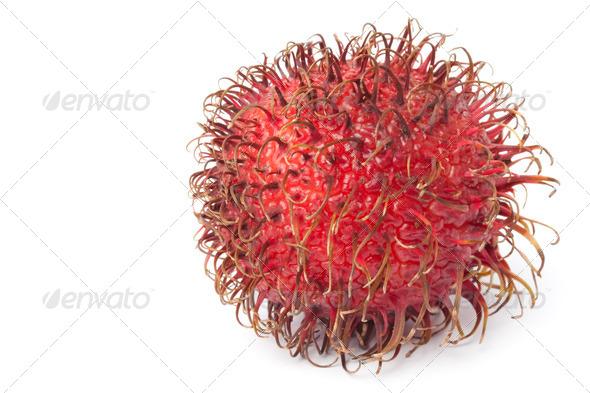 Whole single fresh rambutan - Stock Photo - Images