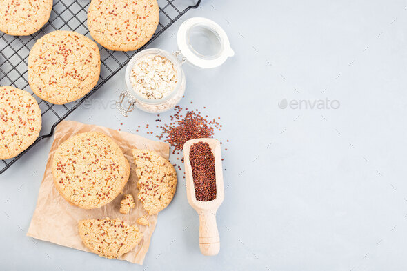 Oatmeal and red quinoa cookies on  table and cooling rack, horizontal, top view, copy space - Stock Photo - Images