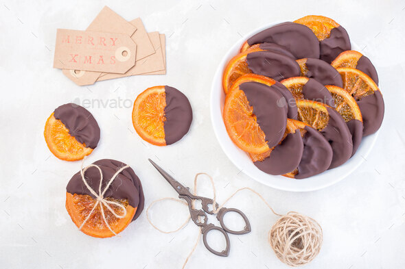 Homemade candied sliced oranges covered with chocolate - Stock Photo - Images