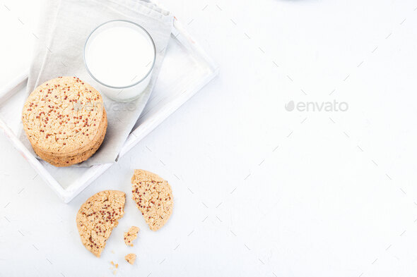 Oatmeal and red quinoa cookies on white tray, horizontal, top view, copy space - Stock Photo - Images