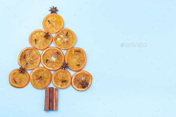 Christmas tree from orange candied slices, cinnamon sticks, anise - Stock Photo - Images