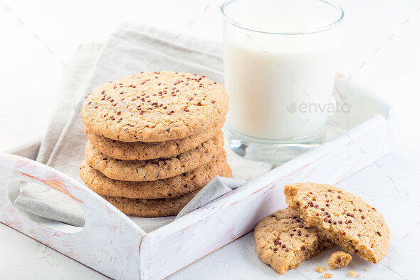 Healthy oatmeal and red quinoa cookies on white tray, served with milk, horizontal, closeup - Stock Photo - Images
