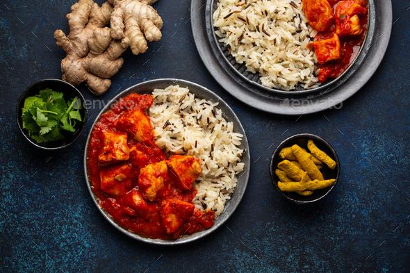 Chicken tikka masala dish with rice - Stock Photo - Images