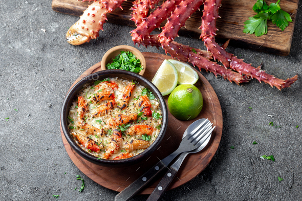 Chilean food. Baked crabmeat crab meat with cheese, cream and bread. Pastel o chupe de sentolla or - Stock Photo - Images