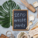 Zero waste party concept. Eco ffriendly tableware, craft bags and monstera leaves on gray background - PhotoDune Item for Sale