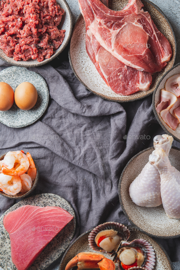 Animal protein sources background with copy space. Carnivore diet concept. Meat, cheese, fish, eggs - Stock Photo - Images