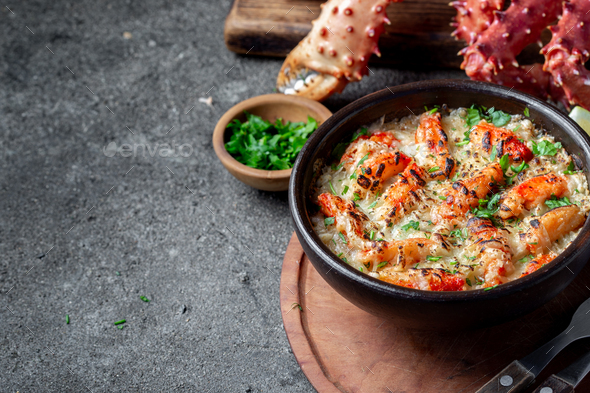 Baked crabmeat crab meat with cheese, cream and bread. Pastel o chupe de sentolla or king crab - Stock Photo - Images