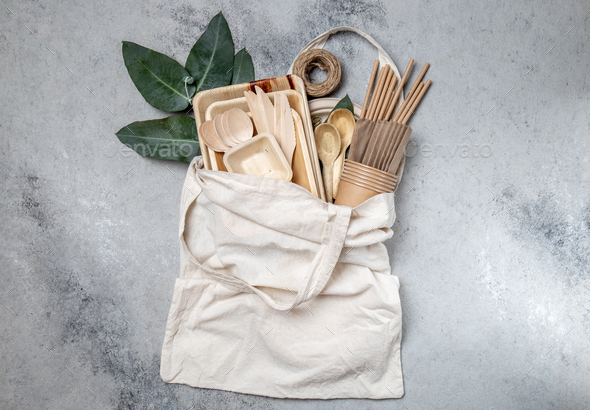 Eco craft paper and wooden tableware - Stock Photo - Images